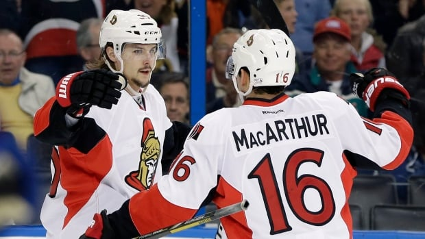 Ottawa Senators defenceman Erik Karlsson, left, celebrates his power-play goal against the Tampa Bay Lightning with Clarke MacArthur, who also scored on the power play later in the game.