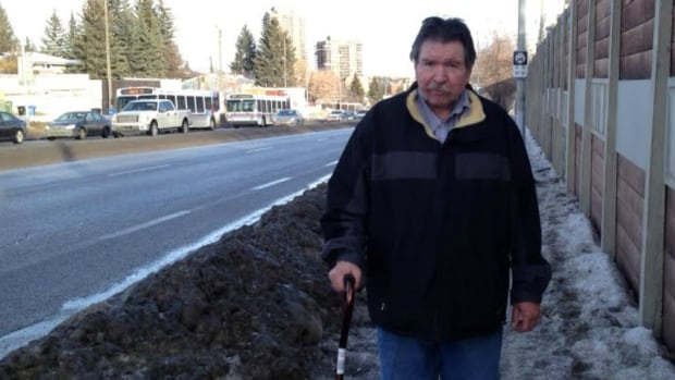 Stephen Babey walks to and from the Southland LRT Station and says the sidewalk he takes to get there is covered in dangerous ice.