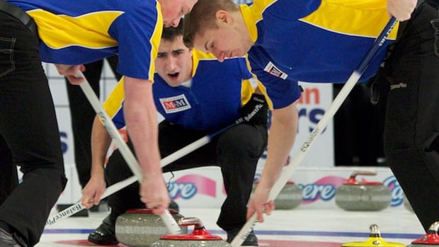 Alberta skip Carter Lautner, middle, encourages sweepers Kyle Morrison, left, and David Aho during Thursday's playoff-clinching victory over Northern Ontario at the junior curling nationals in Liverpool, N.S.