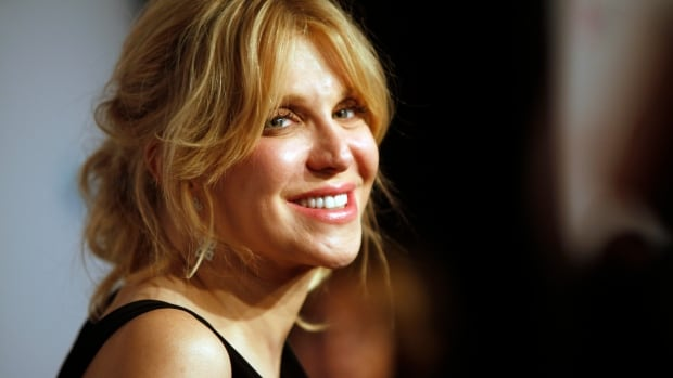 Jury votes in favour of Courtney Love in a 'twibel' case.  In this file picture, Love arrives at the Elton John AIDS Foundation's 12th Annual benefit gala on Tuesday, Oct. 15, 2013.
