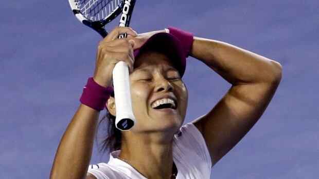 Li Na of China celebrates after defeating Dominika Cibulkova of Slovakia during their women's singles final at the Australian Open tennis championship in Melbourne, Australia on Saturday.