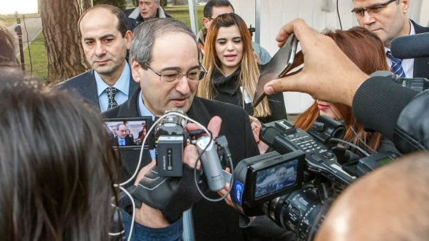 Syrian Deputy Foreign Minister Faisal Mekdad speaks to reporters  at the European headquarters of the United Nations in Geneva on Saturday.