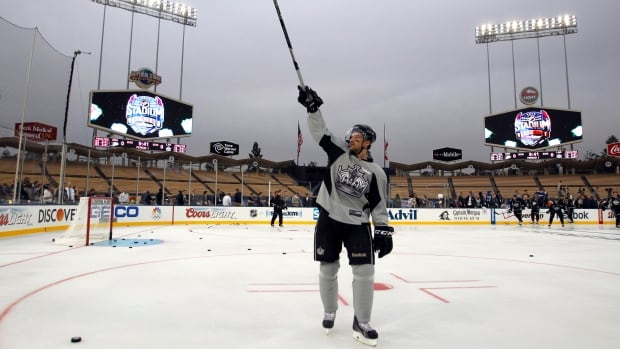 Los Angeles Kings player Justin Williams calls for his family to participate during family skate time after practice for the NHL Stadium Series hockey game Friday, Jan. 24, 2014, in Los Angeles. The Los Angeles Kings and the Anaheim Ducks will play outdoors at Dodger Stadium on Saturday.