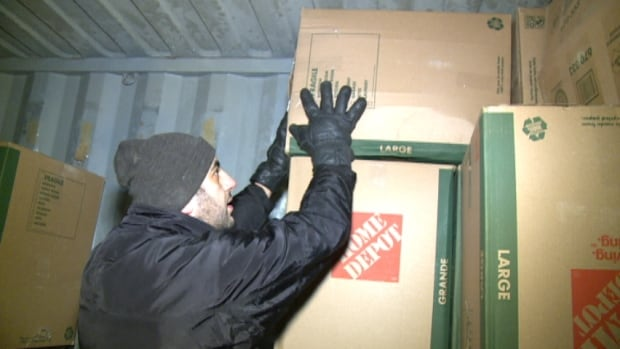 Volunteers packed the container Friday night.