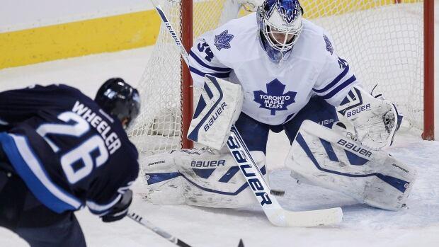 Winnipeg Jets' Blake Wheeler (26) scores on Toronto Maple Leafs goaltender James Reimer (34) during first period NHL action in Winnipeg on Saturday.