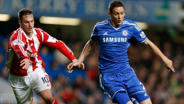 Chelsea's newly-signed player Nemanja Matic, right, dribbles past Stoke City's Marco Arnautovic, left, at the Stamford Bridge ground in London on Sunday.