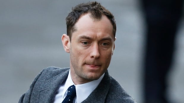 Actor Jude Law arrives to give evidence at the Old Bailey courthouse in London on Jan. 27, 2014. Former News International chief executive Rebekah Brooks and seven other defendants are on trial with various charges related to phone-hacking, illegal payments to officials for stories, and hindering police investigations.