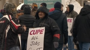 CUPE workers picket the school board offices Monday.