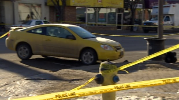 Police taped off a car believed to be involved in a collision that killed a male pedestrian on Whyte Avenue Monday afternoon.