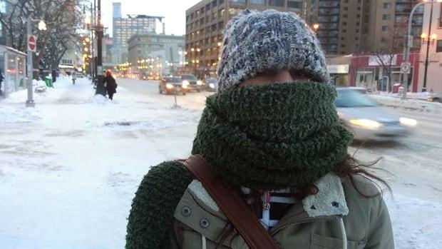 Lorena Kaegi bundles up against the cold on Tuesday morning while walking on Portage Avenue.