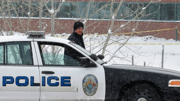 A police cruiser blocks the entrance to Standley Lake HIgh School, where classes were cancelled after an apparent suicide attempt by a student, in Westminster, Colo.,  on Monday, Jan. 27, 2014.