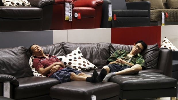 People nap on a couch at an Ikea store in Beijing. China is an expanding market for the furniture retailer, which opened two stores there this year.