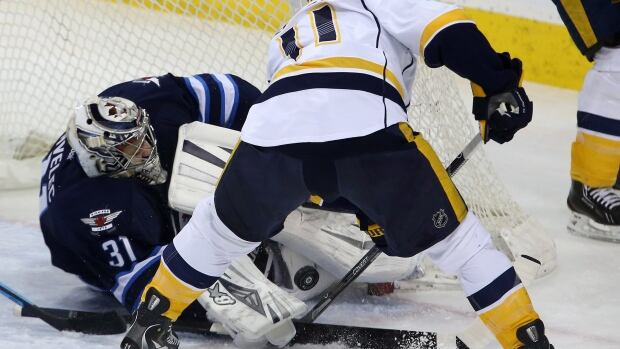 Winnipeg Jets goalie Ondrej Pavelec stops the Nashville Predators' David Legwand right in front of the net during the first period Tuesday at the MTS Centre. The Jets lost 4-3.