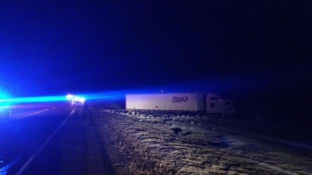A woman was killed when her vehicle crossed over the centre line and crashed head-on with a semi tractor-trailer.
