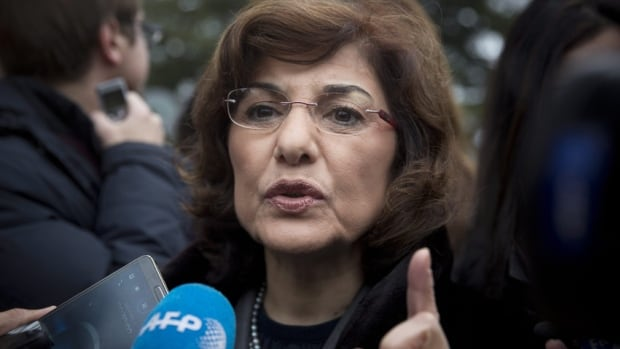 Bouthaina Shaaban, adviser to Syrian President Bashar al-Assad, gestures as she gives a short press briefing upon her arrival to the United Nations headquarters in Geneva, Switzerland, on Sunday, Jan. 26, 2014.