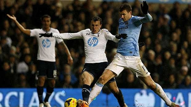 Tottenham Hotspur's Romanian defender Vlad Chiriches vies for the ball against Manchester City's Bosnian striker Edin Dzeko, right, during their match at White Hart Lane in London on Wednesday.