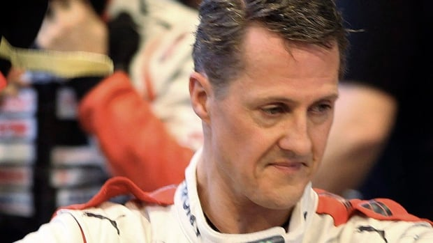 Seven-time Formula One champion Michael Schumacher is out of a coma, and has been moved from a hospital in France to one in Switzerland, months after a skiing accident.