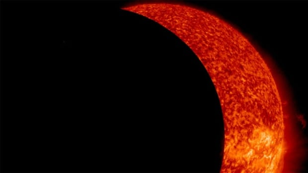 An extreme UV image from NASA's Solar Dynamics Observatory shows the moon eclipsing the sun on Thursday morning.