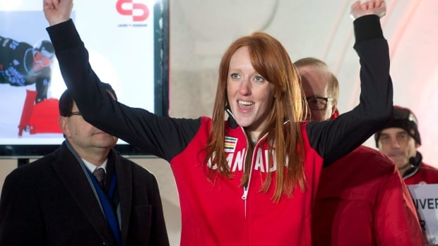 Burlington's Marianne Leeson reacts after receiving her team jacket and being named to the Canadian Olympic snowboard team in Quebec City on Jan 21, 2014. Leeson says she's trying not to focus on any of the violence surrounding Sochi as the Olympics approach.