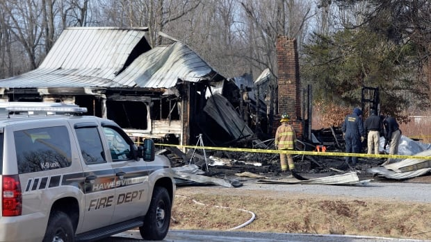 Nine family members were killed early Thursday in a house fire in rural western Kentucky and two people were taken to a hospital for treatment, officials said.