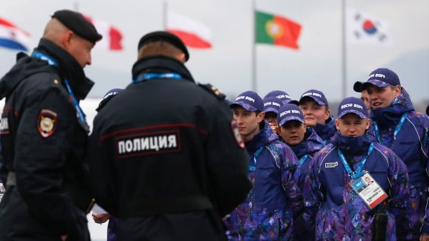 Russian security personnel wait for deployment on Thursday in the Olympic Park as security measures continue to be implemented for the 2014 Winter Olympics.