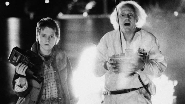 Actors Michael J. Fox, left, and Christopher Lloyd appear in a scene from Back to the Future. A West End musical based on the sci-fi comedy is slated to open in 2015, the 30th anniversary of the film.