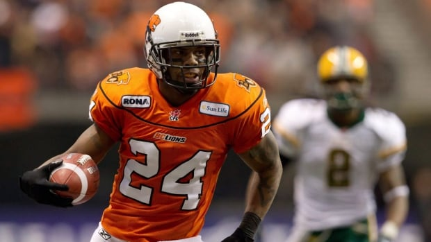 B.C. Lions' Korey Banks carries the ball after intercepting an Edmonton Eskimos pass in a CFL game in 2011.