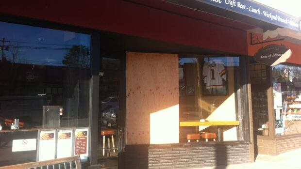 Two thieves smashed windows at Dunbar Public House in Vancouver and make off with several dozen bottles of liquor early Friday morning.