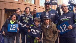 Seahawks fans in Vancouver raise 12th Man flags