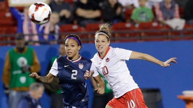 U.S forward Sydney Leroux (2) and Canada defender Lauren Sesselmann (10) chase the ball during the first half of their friendly on Friday.
