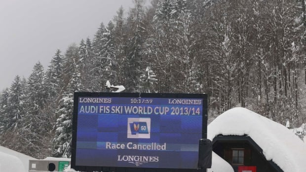"Writing on the electronic billboard reads ""Race cancelled"" at the finish area of an alpine ski, women's World Cup giant slalom , in Kranjska Gora, Slovenia on Saturday."