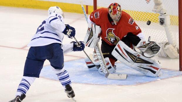 Toronto Maple Leafs' Mason Raymond scores a shoot-out goal on Ottawa Senators' Craig Anderson during NHL hockey action in Ottawa on Saturday, Dec. 7, 2013.