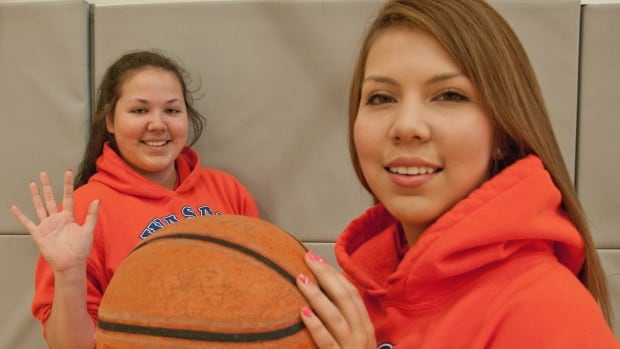 Jessica Lavallee [with ball] and her sister Kaela ham it up at a WASAC summer camp.