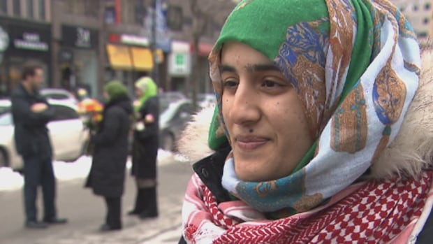 Massouma Al-Bahely and about a dozen other young Muslims were at Phillips Square in Montreal to hand out roses to strangers.