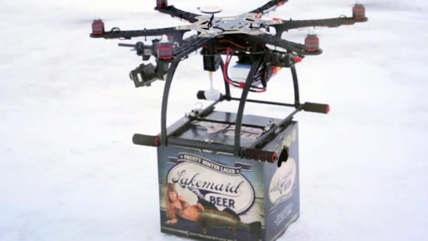 In this Jan. 16, 2014 image from video provided by Lakemaid Beer, a mini-drone lands with a 12-pack of beer for ice fishing anglers on Minnesota's Lake Mille Lacs.
