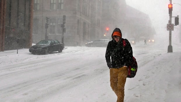 A man walks through the snow on a downtown street in Halifax on Wednesday, Jan. 22, 2014. A major winter storm is expected to bring strong winds and up to 30 centimetres of snow for parts of the Maritimes.
