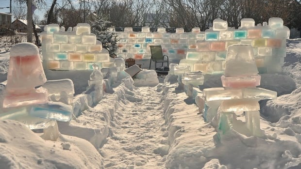 Chris Marchand used about 400 blocks of ice — some coloured with food colouring — to make his backyard fort in Dryden.