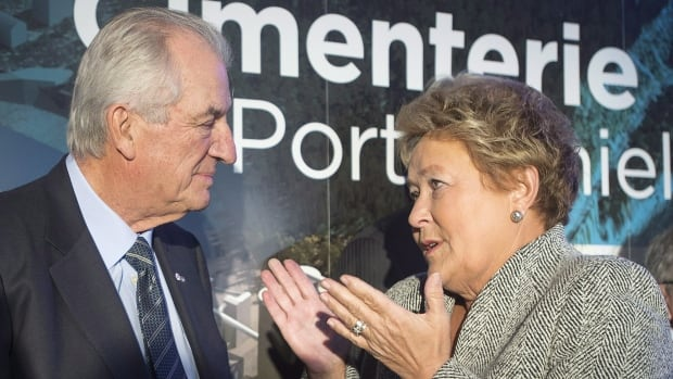 Quebec Premier Pauline Marois chats with Laurent Beaudoin, chairman of Beaudier Inc., at a news conference in Port-Daniel-Gascons, Que. on Friday, January 31, to announce the McInnis Cement's Port-Daniel-Gascons cement plant project.