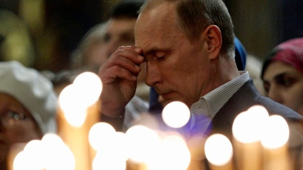 Russia's President Vladimir Putin attends an Orthodox Christmas service at the Holy Face of Christ the Saviour Church in Sochi on Jan. 7. Many Russians believe he has formed a new alliance between Church and state.
