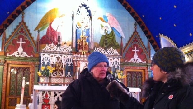 Sister Joan Liss talks with CBC North's Joanne Stassen last year inside Our Lady of Good Hope church in Fort Good Hope, N.W.T.