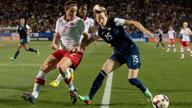 Megan Rapinoe, right, of the U.S. women's national team controls the ball against the Canadian women's squad last week at Toyota Stadium in Frisco, Texas.