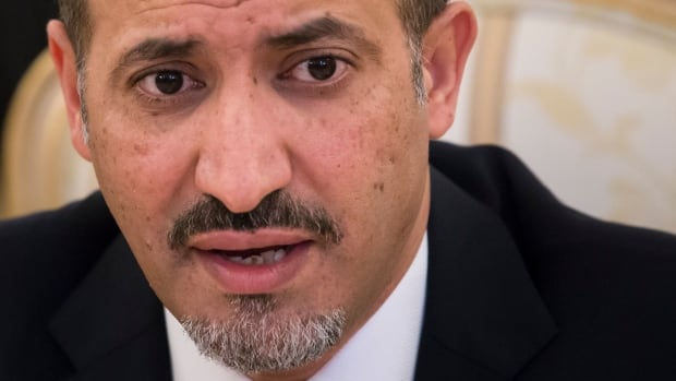 Ahmad Jarba, the head of the delegation of the Syrian National Coalition speaks to Russian foreign minister, Sergey Lavrov, in Moscow on Tuesday. Russia offered assurances on Tuesday that the Syrian government will show up at a new round of peace talks next week and will soon ship more toxic agents abroad for destruction.