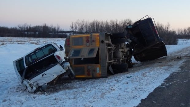 A pickup truck, cattle trailer and school bus were involved in a fatal crash Monday afternoon. One person died and several others went to hospital.