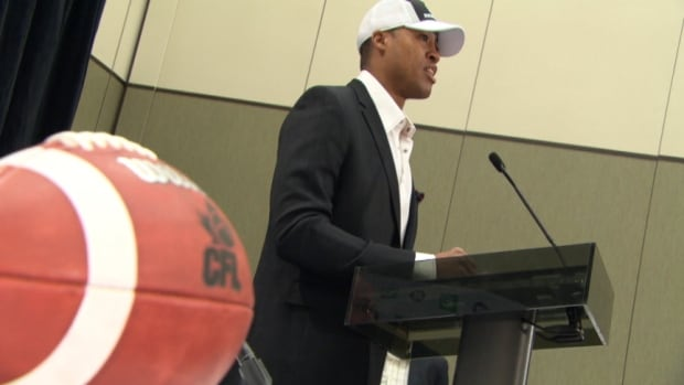 Henry Burris speaks at a news conference after joining the Ottawa Redblacks on a three-year deal. Burris is expected to be the starting quarterback when the expansion team plays its first-ever regular season game July 3.