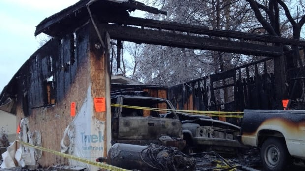 A garage that exploded in Mill Woods Monday, killing two and injuring a third person, was the workshop of a man who loved working on cars, a neighbour said.