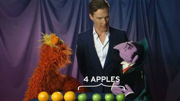 British actor Benedict Cumberbatch, centre, appears in a skit with Sesame Street characters Murray Monster, left, and Count von Count.