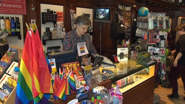 Peg Norman is selling gay pride flags at The Travel Bug at 50 per cent off for customers who will display the flag during the Sochi 2014 Winter Olympic Games.