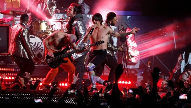 The Red Hot Chili Peppers perform during the halftime show of the NFL Super Bowl XLVIII football game between the Seattle Seahawks and the Denver Broncos. Bassist Flea says in letter to fans that the band pretended to play along to a pre-taped track.
