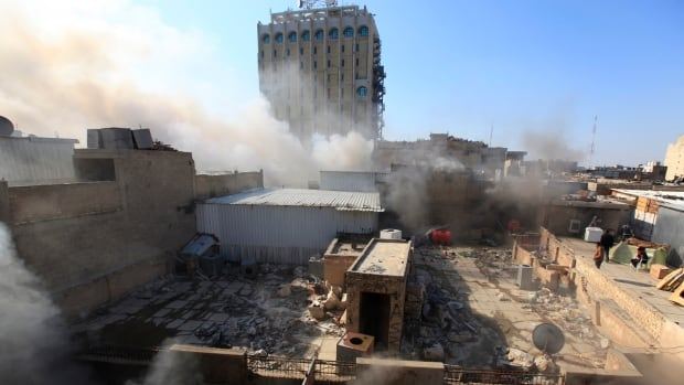 Smoke rises from the site of a bomb attack near Khullani Square in Baghdad on Wednesday, one of several attacks that killed more than 30 people in the Iraqi capital.