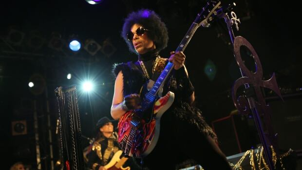 Prince is seen performing with his band 3rd Eye Girl in London on Tuesday night.
